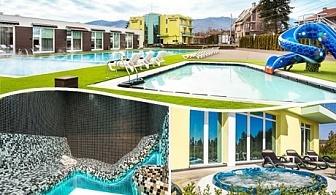 Делник в Долна Баня! Нощувка на човек + 3 открити басейна + 2 външни джакузита + сауна и парна баня с минерална вода в Комплекс Европа***