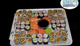 Изгодно предложение! 60 суши хапки с пушена сьомга, филаделфия и херинга от Sushi Market