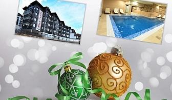 Коледа в Банско! 2 нощувки на човек в апартаментна част със закуски, по желание вечери, едната празнична + басейн и уелнес пакет от хотел Роял Парк****