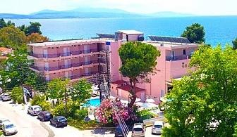 LASTI MINUTE: 18 - 24 Май на първа линия в Гърция, само на 30м. от плажа.! 2 нощувки на база All Inclusive light+ басейн в Golden Beach Metamorfosi 3*, Халкидики