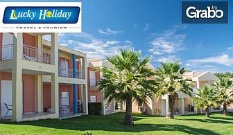 Лятна почивка през Юли на остров Корфу! 4 нощувки със закуски и вечери в хотел Olympion Village 3*, плюс транспорт