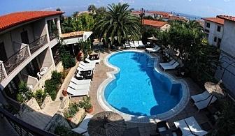 Майски празници в Гърция! Три нощувки със закуски в хотел Stamos, Халкидики