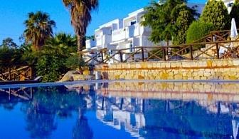 МОРЕ 2017 в Еко Хотел Agionissi Resort 4*, на остров Амулянѝ! Нощувка със закуска и вечеря + Открит плувен басейн + спа център!