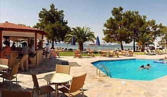 На море през МАЙ в Тасос! Хотел Rachoni Bay Resort за една нощувка, закуска, вечеря, открит басейн с бар до него и чадъри и шезлонги / 01 Май 2018 до 23 Май 2018 г.