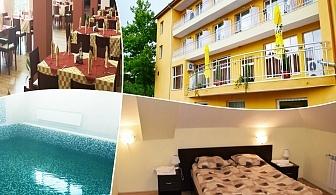 Нощувка на човек със закуска, обяд и вечеря + минерален басейн и 1 процедура на ден от хотел Божур, с. Минерални Бани, Хасково