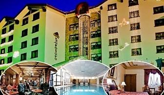 Нощувка на човек със закуска + топъл басейн и СПА в Хотел Пампорово 5*