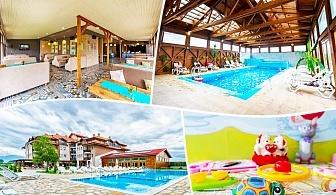 Нощувка на човек със закуска и вечеря* + минерален басейн и релакс пакет в хотел Севън Сийзънс, с.Баня до Банско