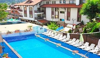 Нощувка за двама със закуска + 2 топли минерални басейна и СПА зона от хотел Аквилон Резидънс & СПА, с. Баня