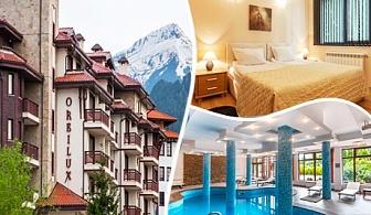 Нова година в Банско. 3, 4 или 5 нощувки на човек със закуски и вечери, празничен куверт + басейн с ТОПЛА вода в хотел Орбилукс***