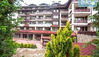 Почивка в Банско през декември в Апартхотел Орбилукс! Нощувка със закуска и вечеря, вътрешен  басейн, сауна, парна баня, безплатно за дете до 3г.