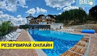 Почивка в хотел Хот Спрингс Медикал и СПА 4* в село Баня! Нощувка със закуска и вечеря, ползване на вътрешен и външен басейн, хамам, парна баня, солна стая, финландски сауни, rain walk, лакониум и още