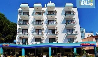 Почивка в края на лятото в Кушадасъ, Турция! 7 нощувки със закуски и вечери в Hotel Melike 2* и транспорт от туроператор Поход!