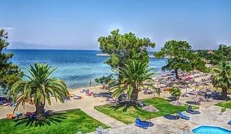 От 16.05 до 03.06 на самия плаж в Скала-Рахониу, о. Тасос! Нощувка със закуска и вечеря + частен плаж и басейн от хотел Rachoni Bay Resort
