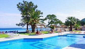 Семейна почивка през лято 2020 на 1-ва линия на о. Тасос! Нощувка със закуска и вечеря за двама с две деца + частен плаж и басейн от хотел Rachoni Bay Resort