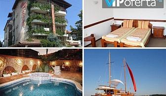Тридневни, петдневни и седемдневни пакети за двама със закуски + разходка с лодка в Хотел М1, Приморско