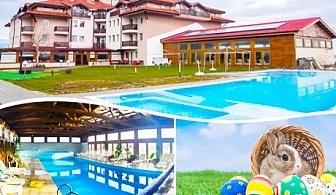 Великден и Гергьовден край Банско с горещ минерален басейн! 3 нощувки на човек със закуски и вечери + релакс център от хотел Севън Сийзънс, с.Баня