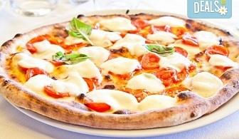 Вкусно и изгодно предложение! Вземете пица по Ваш избор oт Hubi-Brothers в Княжево!