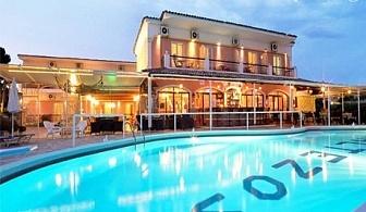 Юли и Август на остров Корфу, Гърция! Нощувка със закуска за двама  + басейн в хотел Maltezos, Гувия