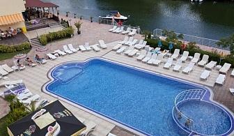 На Южният плаж в Приморско - хотел Перла Сън Парк за една нощувка със закуска, чадъри и   шезлонги на басейна / 01.06.2017 - 24.06.2017