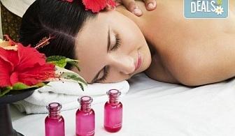 Заредете тялото си с енергия! 120-минутен Ломи-ломи хавайски масаж, пилинг с кокосови стърготини, Hot Stone терапия и йонна детоксикация в център GreenHealth