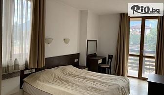 Зимна почивка в сърцето на Банско! Нощувка със закуска + шатъл до лифта и БОНУСИ, от StayInn Banderitsa Apartments